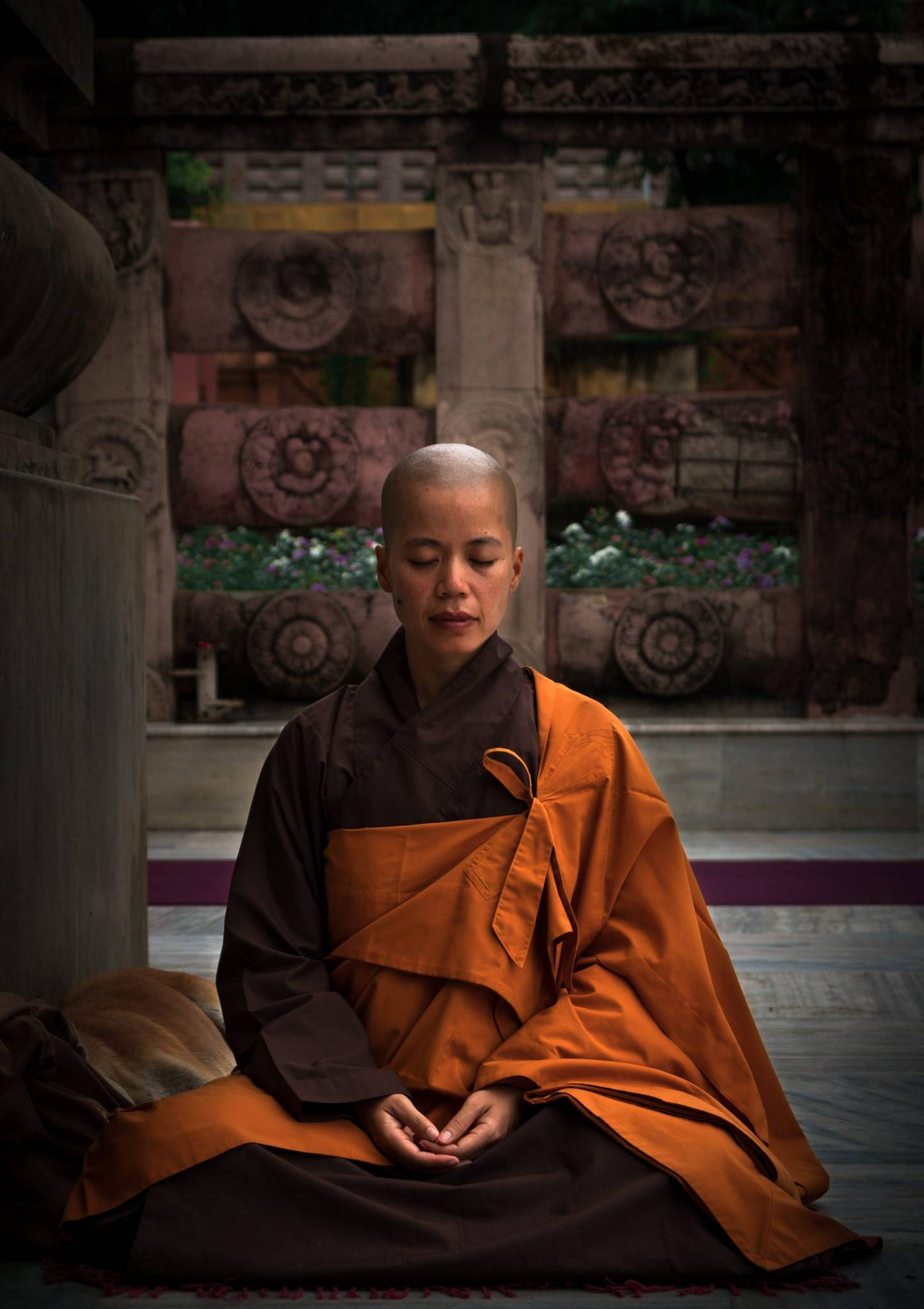 selective focus photography of monk during meditation 2421467 scaled